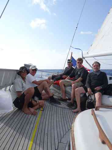 The crew of Voyager take a moment on the aft deck, during a hard tack.  From left; Larry, Guillermo, Greg, Forrest, Geraldo.  Taken during the Marion to Bermuda race in 2013.