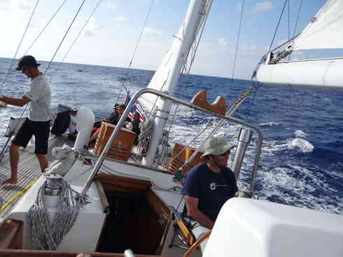 Voyager makes way with Ross at the helm and Larry on deck.  Taken during the Marion to Bermuda sailing race in 2013.