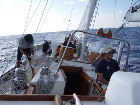 Voyager makes way with Ross and Larry on watch.  Taken during the Marion to Bermuda sailing race, 2013.