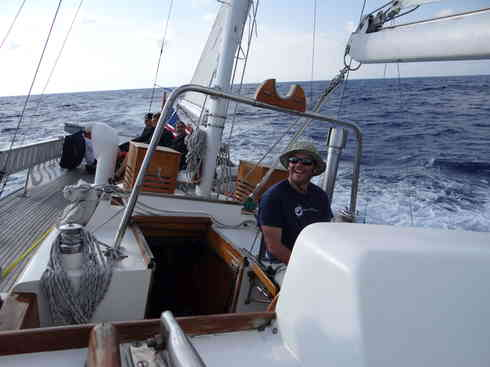 Voyager crew member Ross cracks a smile while at the helm.  Taken during the Marion to Bermuda sailing race, 2013.