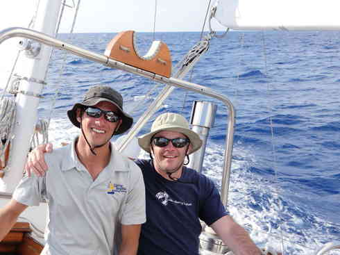 Larry (left) and Ross at the helm as Voyager makes way.  Marion to Bermuda sailing race, 2013.