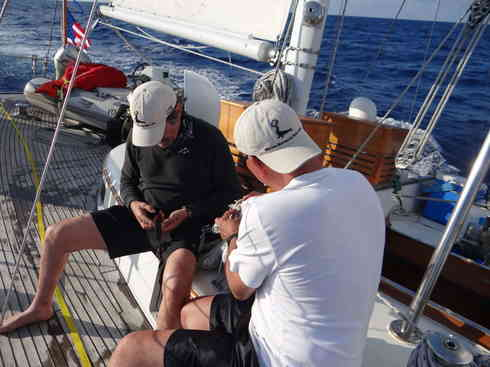 Geraldo and Dr. Guillermo make emergency repairs to Voyager's stalwart watchman.  Marion to Bermuda race, 2013.