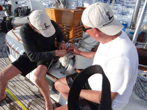 Geraldo and Dr. Guillermo make emergency repairs to Voyager's stalwart watchman.  Marion to Bermuda sailing race, 2013.