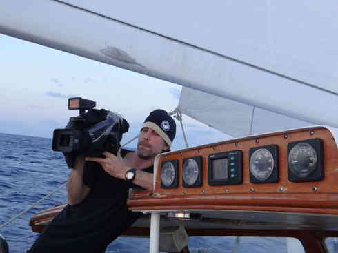 Crew member and producer Greg records on board Voyager.  Taken during the Marion to Bermuda sailing race, 2013.