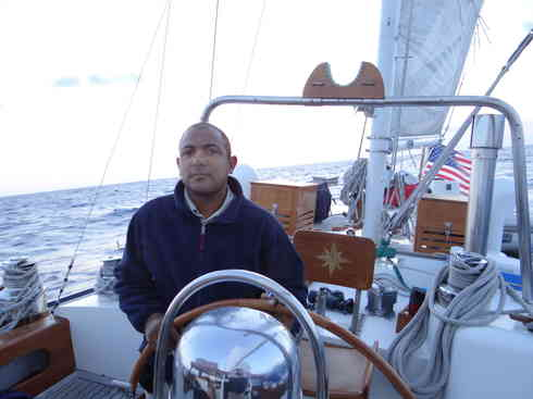 Kevin at the helm of Voyager during the Marion to Bermuda 2013 sailing race.