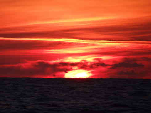 A fiery sunset from on board Voyager.  During the Marion to Bermuda sailing race, 2013.