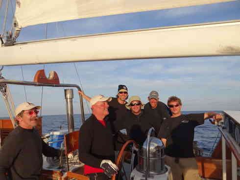 Voyagers' crew gathers in the cockpit.  From left; Geraldo, Dr. Guillermo, Greg, Ross, Larry, Forrest.  Taken during the Marion to Bermuda sailing race in 2013.
