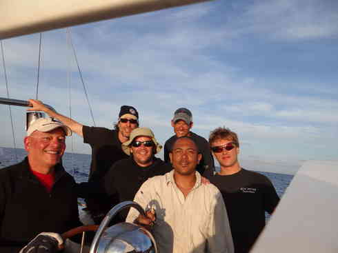 Voyagers' crew gathers in the cockpit.  From left; Dr Guillermo, Greg, Ross, Kevin (front), Larry, Forrest.  Taken during the 2013 Marion to Bermuda sailing race.