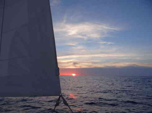 Voyager sails with a sunrise.  Marion to Bermuda sailing race, 2013.