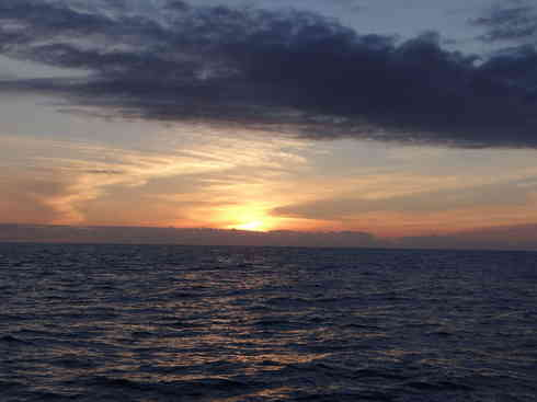 Voyager catches a beautiful sunrise on the deep blue.  Marion to Bermuda sailing race, 2013.