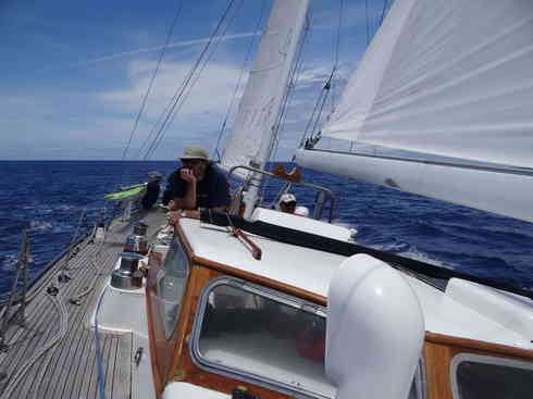 Voyager crew member Ross keeps watch during the Marion to Bermuda sailing race, 2013.