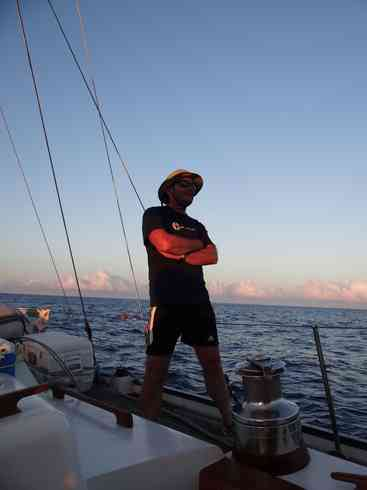 Voyager crew member Ross catches the first few rays of light.  Marion to Bermuda sailing race, 2013.