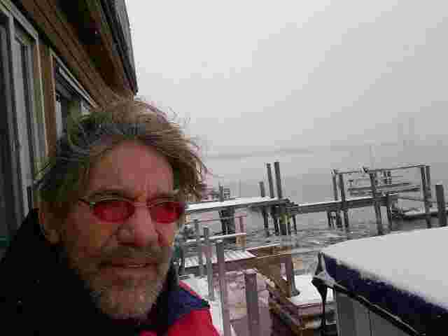 Geraldo on the Hudson River in Edgewater New Jersey, with a foggy George Washington bridge visible in the background.