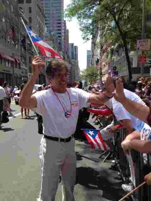 Geraldo marching in the Puerto Rican Day parade, a Great Day with Fox News Latino.