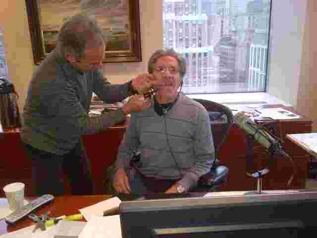 Producer Marty Berman gets ready to trim Geraldo's mustache on air, 77 WABC radio.