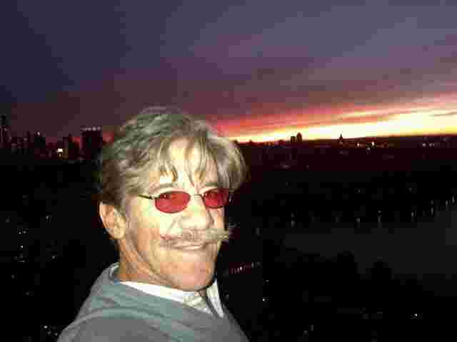 Geraldo with the beautiful NYC night skyline.