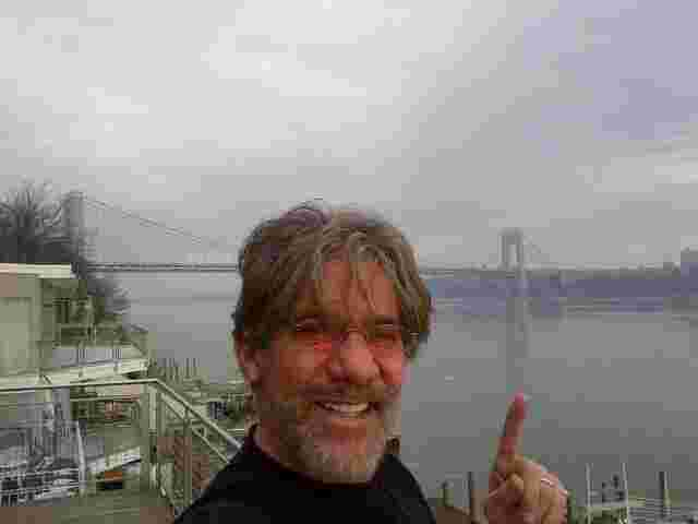 Geraldo overlooking a foggy Hudson river from Edgewater NJ, with the George Washington bridge in the background.
