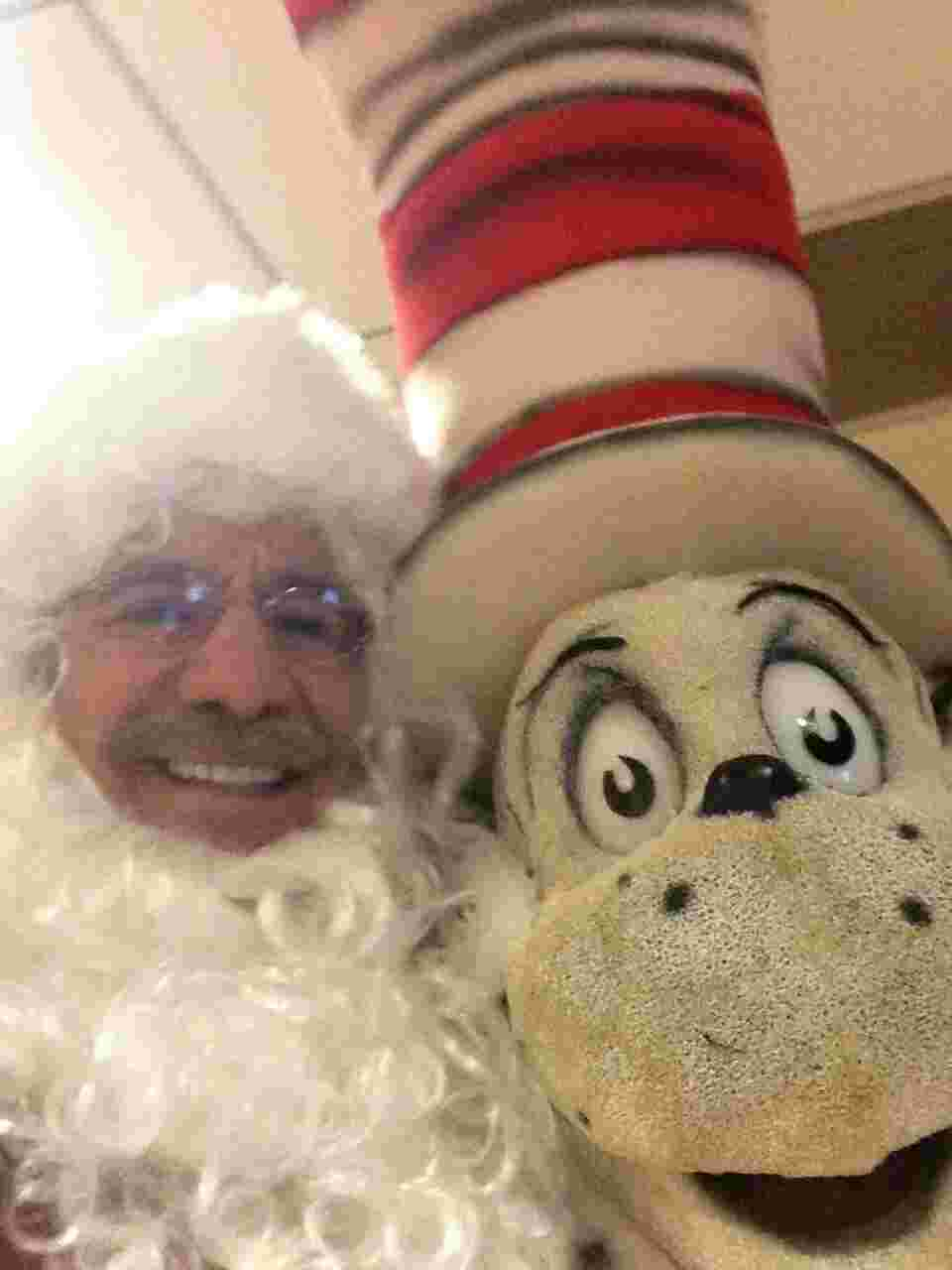 Geraldo as Santa Claus poses with Cat In The Hat.