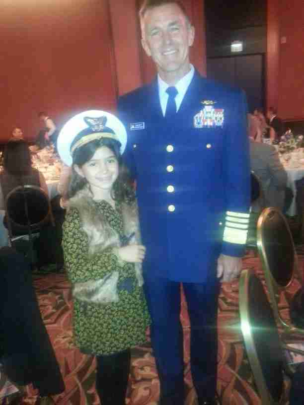 Geraldo's youngest daughter Sol shares a moment with Admiral Zukunft, Commandant of the U.S. Coast Guard