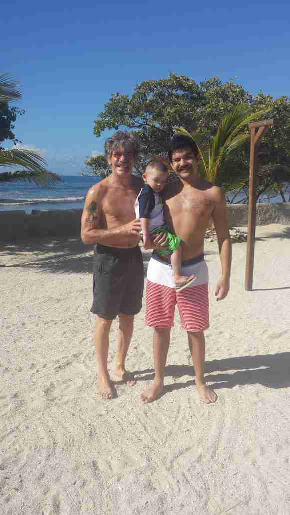 Geraldo on island near Salinas, Puerto Rico takes a moment with his younger son Cruz and grandson Jace.
