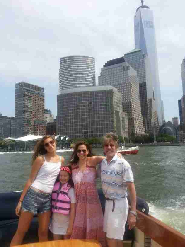 Geraldo, wife Erica, youngest daughter Sol and daughter Simone take in Manhattan during a ride on the Hudson river in vessel Belle.