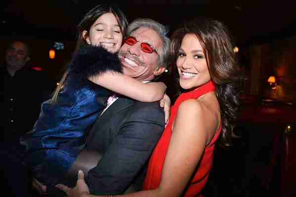 Geraldo holds a buoyant youngest daughter Sol as they celebrate mom Erica's 40th in New York City,