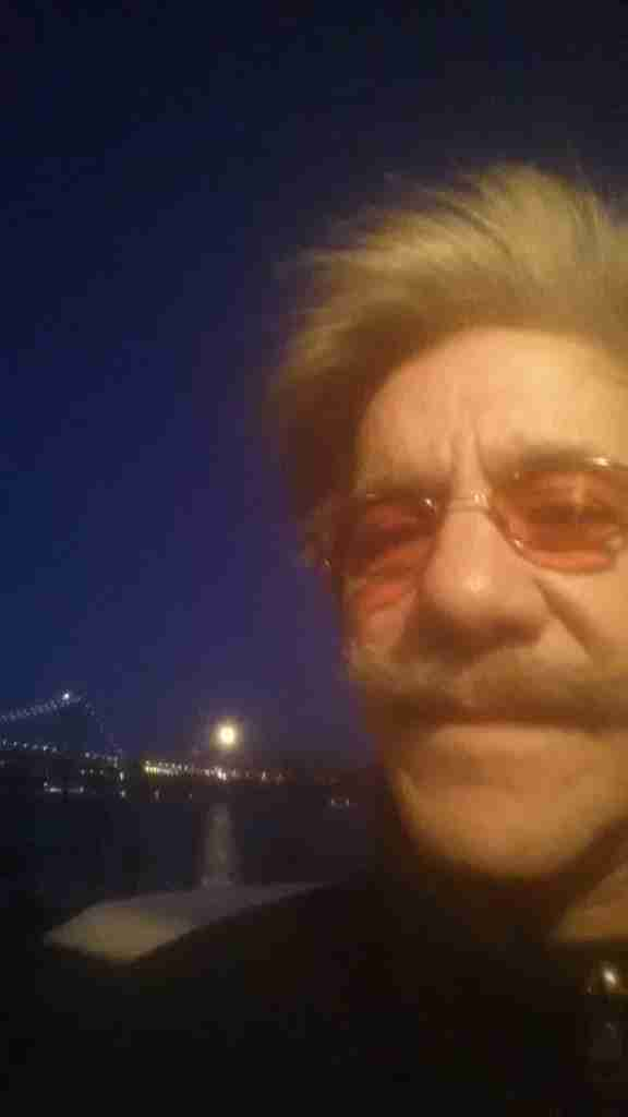 Geraldo takes in the full moon over the George Washington bridge, as seen on the Hudson from Edgewater New Jersey.