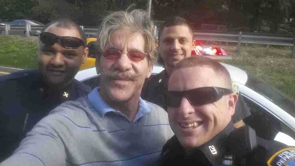 Geraldo with youngest daughter Sol meets NYPD officers in NYC.