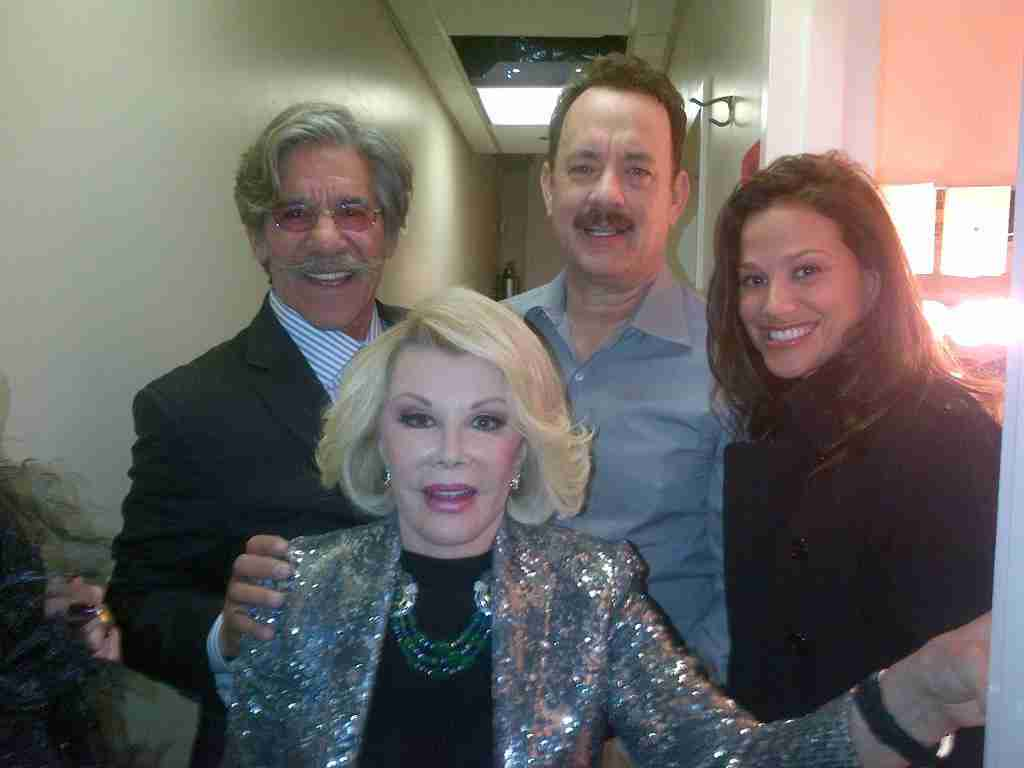 Geraldo with actor Tom Hanks, Joan Rivers, and his wife Erica, sharing a moment backstage.