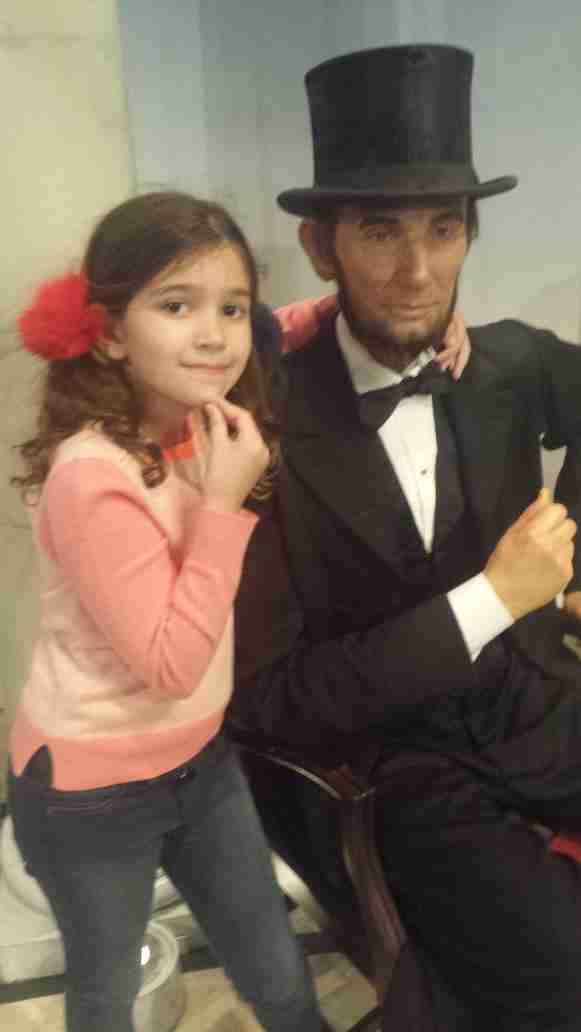 Youngest daughter Sol Rivera reflects with Abe Lincoln.
