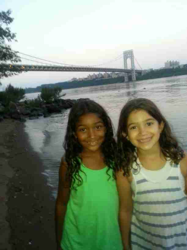 Geraldo's youngest daughter Sol and her friend Lola taking in the Hudson river, with George Washington Bridge in the background.