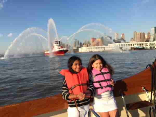 Youngest daughter Sol and her friend Lola appreciating an FDNY salute.