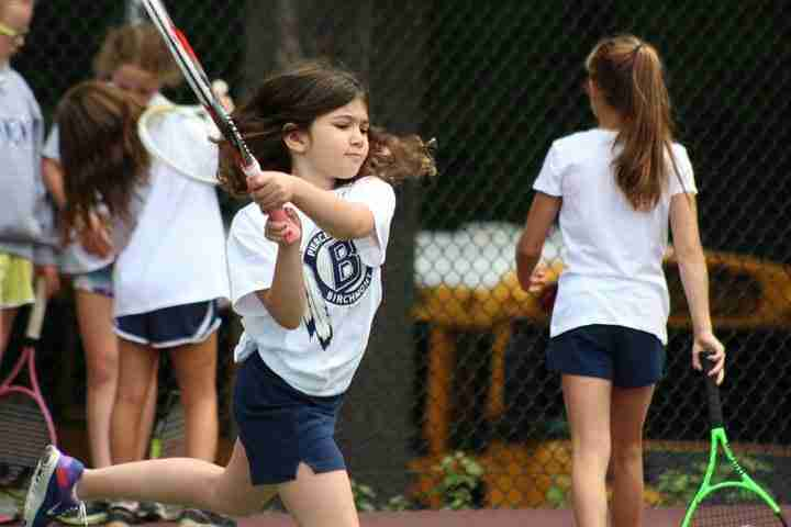 Youngest daughter Sol shows a swing during tennis at her school.