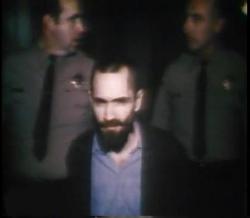 Charles Manson in handcuffs
